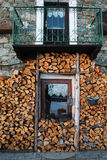 Woodpile and window of a typical chalet in italian alps Royalty Free Stock Image