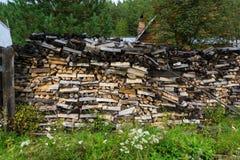 Woodpile. In Ust-Kaspa village. Eastern Sayan, Siberia, Krasnoyarsk region, Russia. Horizontal shot Royalty Free Stock Photo