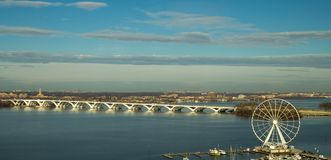 Woodrow Wilson Bridge and Ferris Wheel. Completed in 2008 between Alexandria and Maryland and crossing Washington DC this new drawbridge over the Potomac River Royalty Free Stock Images