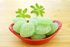 Woodruff and Candies in porcelain dish Stock Photo