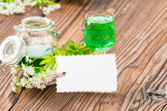 Woodruff syrup with signboard Stock Image