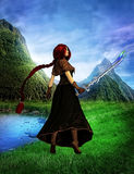 The woods battle priestess in a beautiful landscape Royalty Free Stock Photo
