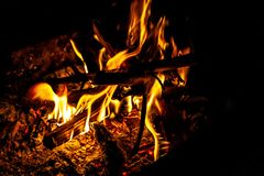 Woods burning with yellow flame in barbecue box, on black  stock images