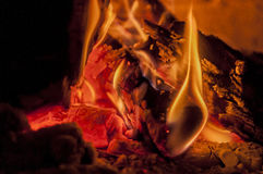 Woods in fireplace. Woods are burning in fireplace Royalty Free Stock Photos