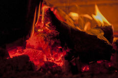 Woods in fireplace. Log is burning in fireplace Royalty Free Stock Image