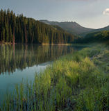 Woods Lake. Soft evening light skims across Woods Lake near Telluride. The surrounding scenery is mirrored in the calm water of the lake Royalty Free Stock Images