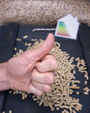 Woods pellets and thumbs up Stock Photography