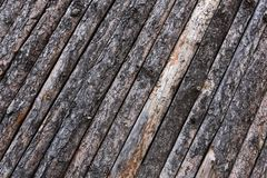 Rough woods wall.background textures. Woods wall with barks, nature texture Royalty Free Stock Photo