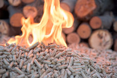 Woods and wooden pellets. Pile of Wooden pellets in fire in front wooden wall royalty free stock photo