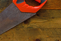 woodsaw on rustic wooden work bench Royalty Free Stock Photos