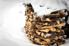 Woodshed almost completely covered by snow Stock Photos
