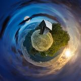 Woodshed on little planet spherical panorama. Time change concept over the woodshed on little planet spherical panorama. beautiful countryside concept with 360 Royalty Free Stock Photography