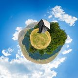Woodshed on little planet spherical panorama. Beautiful countryside concept with 360 degree view. abandoned building on a meadow among the forest in summer Royalty Free Stock Photography