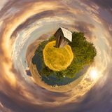 Woodshed on little planet spherical panorama. At sunset. beautiful countryside concept with 360 degree view. abandoned building on a meadow among the forest in Stock Photography