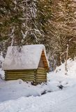 Woodshed by the road in winter forest. Lovely nature scenery Stock Photography