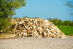 Woodstack. A stack of wood on a field Stock Photos