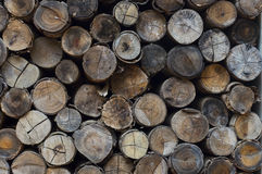 Woodstack background. Stacked logs background texture Royalty Free Stock Photos
