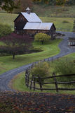 Woodstock barn in Vermont in Fall. Autumn shines through in a rural Vermont scene Stock Image