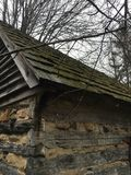 Woodsy Cabin. With mossy roof Royalty Free Stock Photo
