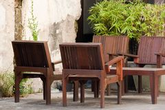 WoodTables and chairs. Tables and chairs in front of the store Stock Image