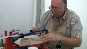 Woodturning club member showing his skill stock video