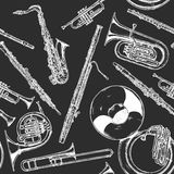 Woodwind and brass musical instrument. Seamless pattern with woodwind and brass musical instrument. Vector illustration in vintage engraved style on black Royalty Free Stock Image