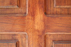 Woodwork. Closeup of a massive wooden door Stock Image