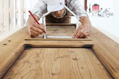 Free Woodwork Concept, Carpenter With The Meter Makes The Shape Of A Stock Image - 119699811