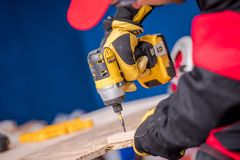 Woodwork with Drill Driver stock images