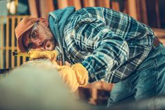 The Woodwork Passion. Caucasian Men and the Beam. Building Using Wood Material stock photos