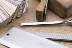 Woodwork. Tools and samples of inlay on wooden table royalty free stock photography
