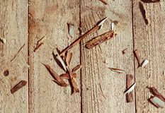 Woodwork: wood shavings on a light wooden background stock images