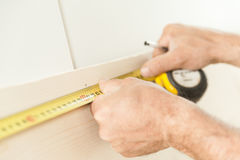 Woodworker artisan in his workshop measuring Royalty Free Stock Images