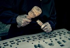 Woodworker with chisel. Detail of a wood carving worker royalty free stock image
