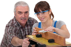 Woodworker and female apprentice Royalty Free Stock Images