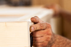 Woodworker hands with wooden board Royalty Free Stock Photography