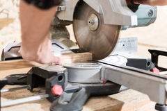 Woodworker is laboring on professional machine Royalty Free Stock Photography