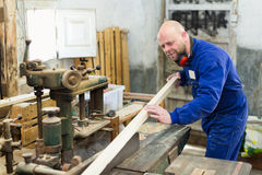 Woodworker on lathe in workroom Royalty Free Stock Photos