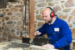 Woodworker on lathe in workroom Stock Photo