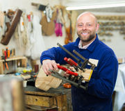 Woodworker on lathe in workroom Royalty Free Stock Image