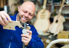 Woodworker on lathe in workroom Royalty Free Stock Images