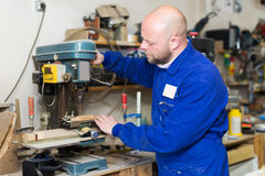 Woodworker on lathe in workroom Stock Photos