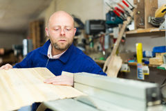 Woodworker on lathe in workroom Royalty Free Stock Photography