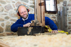 Woodworker on lathe in workroom Stock Photography
