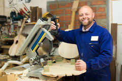 Woodworker on lathe in workroom Stock Image
