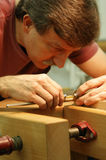 Woodworker Making Close Measurement. Close-up view of a woodworker making a very precise measurement Royalty Free Stock Photo