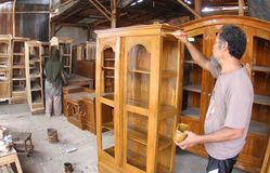 Woodworker making furniture royalty free stock images