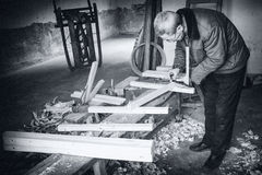 Woodworker. A man was doing his woodwork seriously Royalty Free Stock Photography