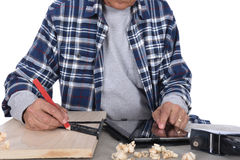 Woodworker Marking Board Stock Photography
