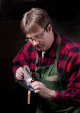 Woodworker Planes a board Royalty Free Stock Photos